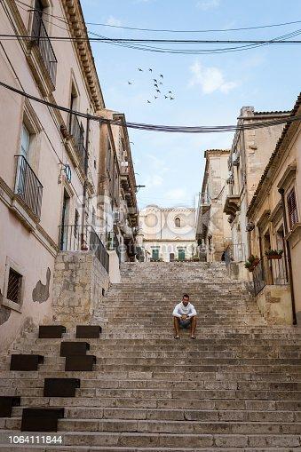 Noto, Sicily, Man sitting on steps