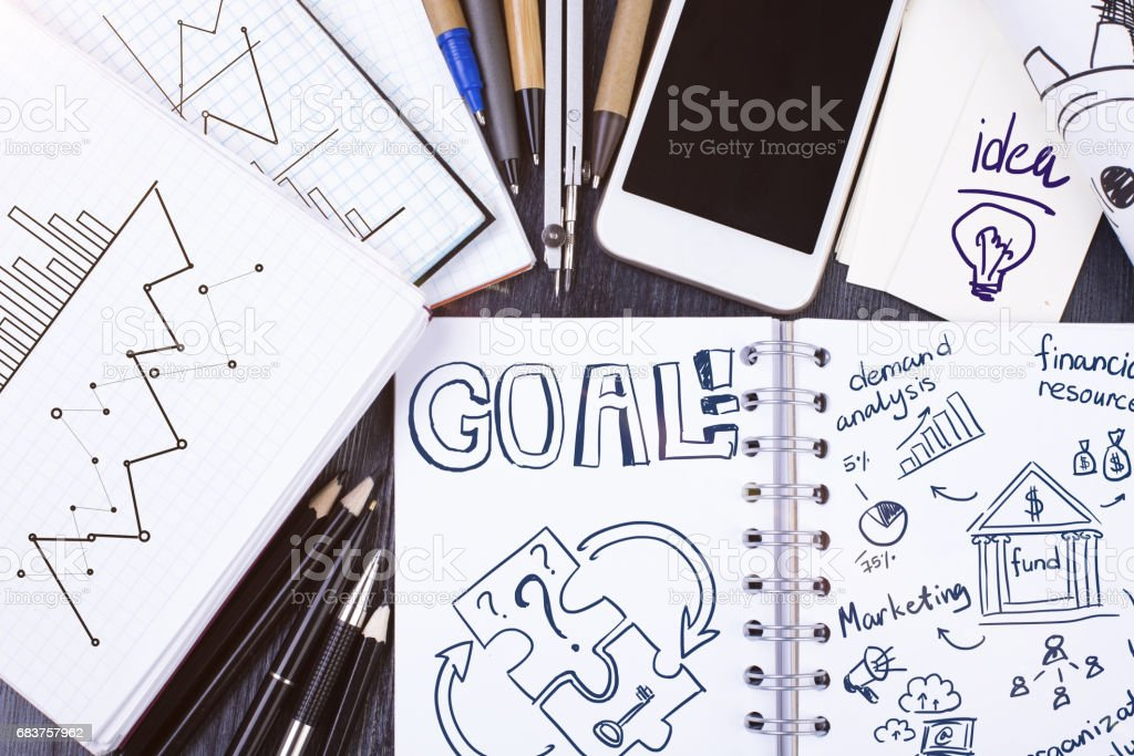 Notpad with goal sketch stock photo
