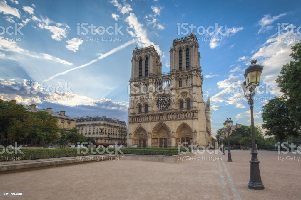 Notre Dame cathedral in Paris, France, at sunrise. stock photo