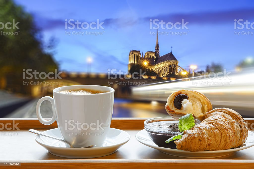 Notre Dame cathedral with coffee and croissants in Paris, France stock photo