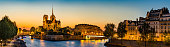 Notre Dame de Paris, France, panoramic view of Seing river at sunset