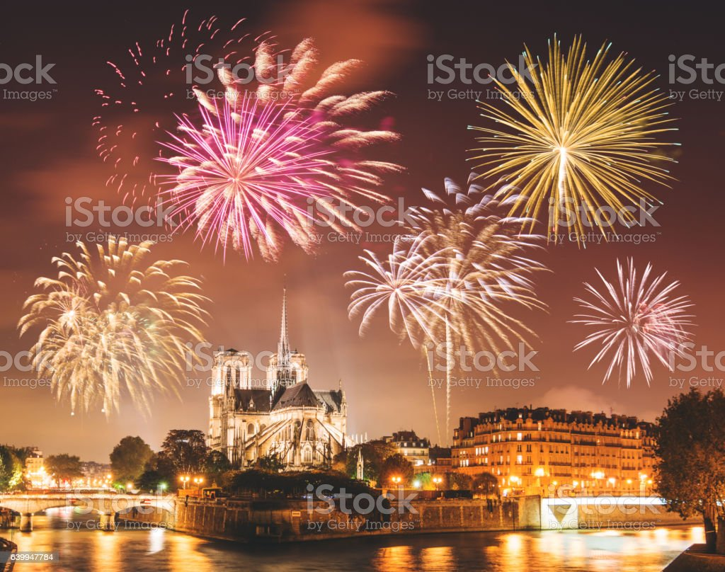 Notre Dame de paris in night with fireworks stock photo
