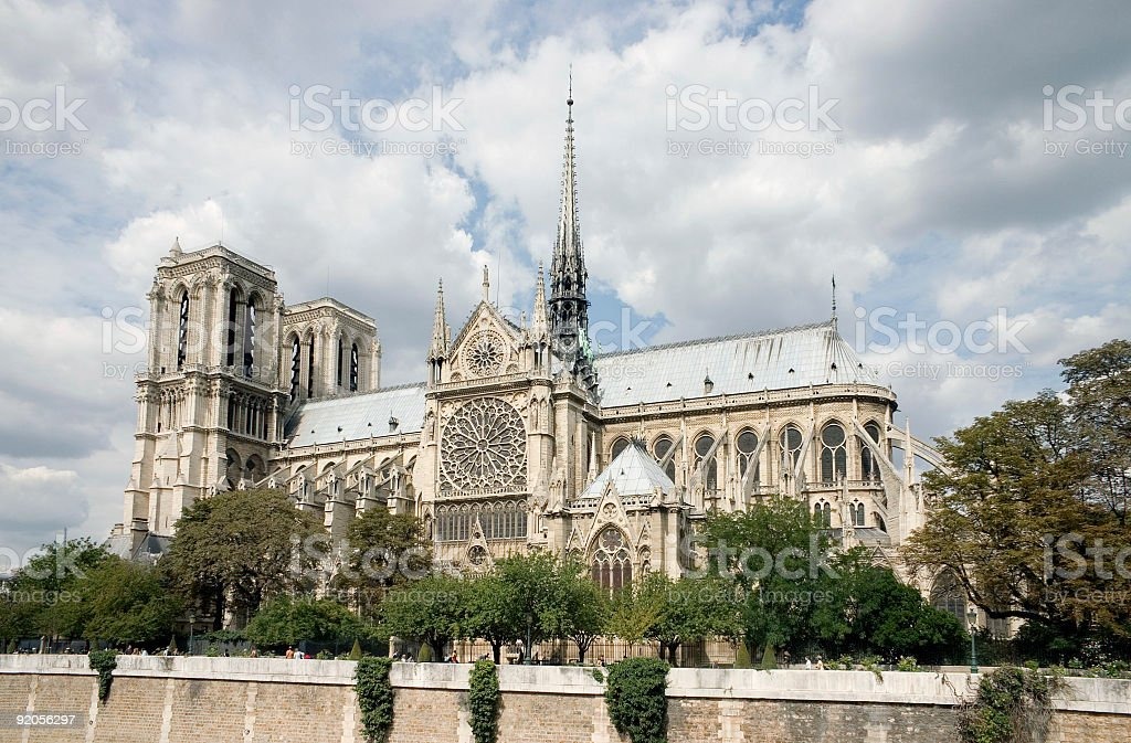 Notre Dame exterior with clouds royalty-free stock photo