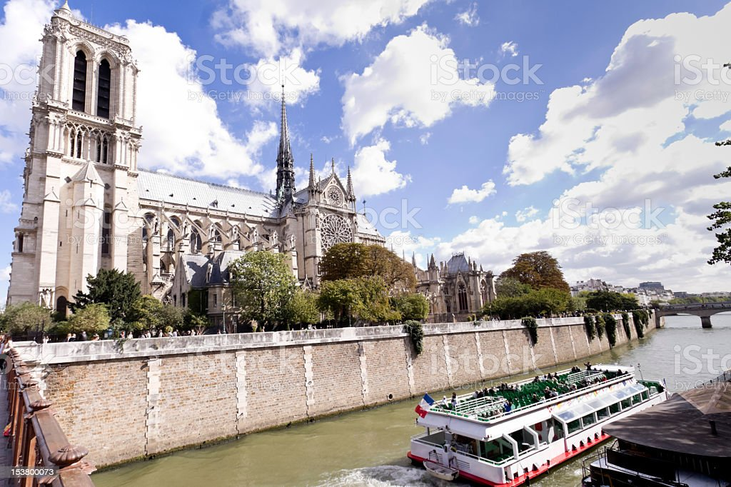 Notre Dame on Seine River with Tour Boat stock photo