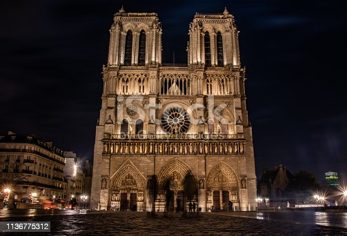 Long exposure night shot of Notre Dame in Paris, France.