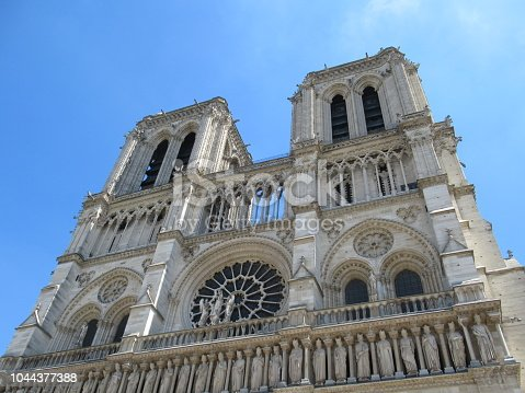 Front view of Notre-Dame Cathedral in Paris, France, on a sunny day.