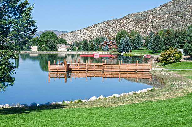 Nottingham Lake in Avon, Colorado Nottingham Lake is centrally located in the middle of Avon, Colorado, providing all kinds of outdoor summer activities like paddle boarding and paddle boating, water yoga, and kayaking.  It is at the base of the Beaver Creek Ski Resort and only ten minutes from Vail. beaver creek colorado stock pictures, royalty-free photos & images