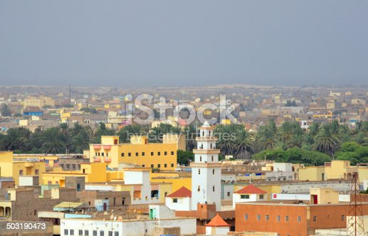 Nouakchott, Mauritania: skyline of the sprawling Moor capital - buildings, palm trees and minaret - photo by M.Torres