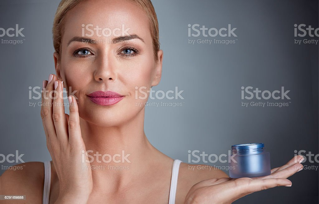 Nourished woman with cream stock photo