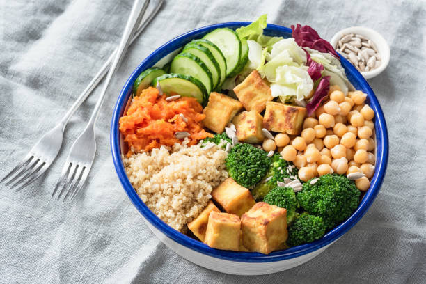 nourishing buddha bowl with tofu, quinoa and vegetables - vegetarian stock photos and pictures