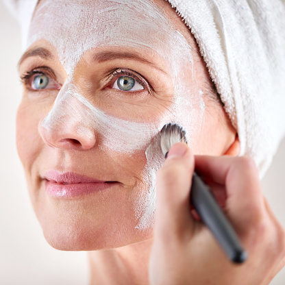 491713766 istock photo Nourishing her skin with a facial treatment 491714034