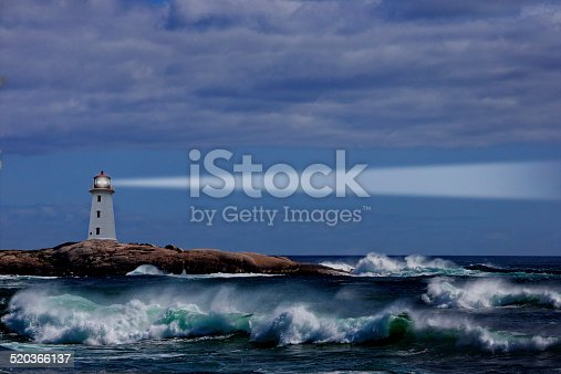 A lighthouse sits on the rocky shores of Nova Scotia.