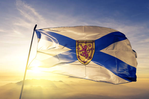 nova scotia province of canada flag textile cloth fabric waving on the top sunrise mist fog - nowa szkocja zdjęcia i obrazy z banku zdjęć