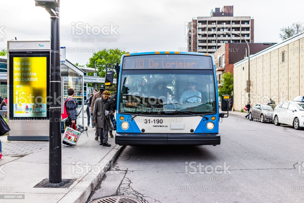 Novabus bus in city in Quebec region with people getting on stock photo