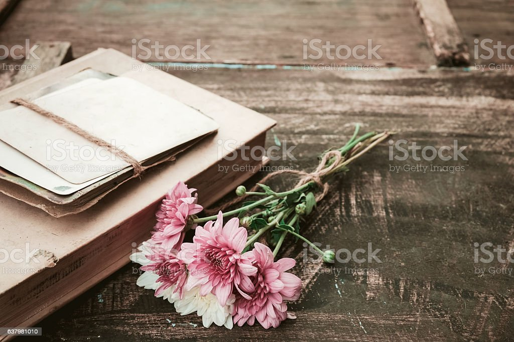 novel books with bouquet of flowers stock photo