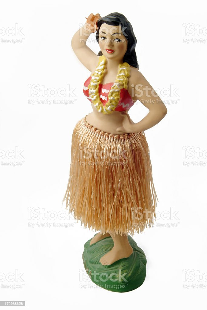 Novelty Antique Hula Girl Figurine on a White Background stock photo