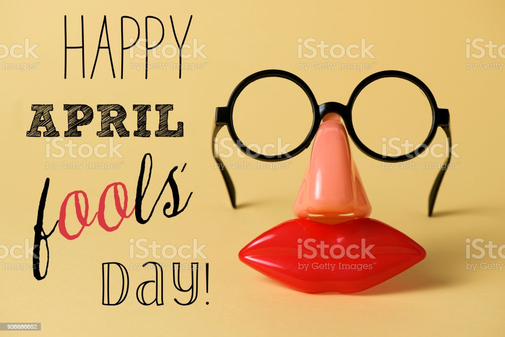novelty glasses and text happy april fools day stock photo