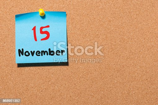 868951648 istock photo November 15th. Day 15 of month, color sticker calendar on notice board. Autumn time. Empty space for text 868951352