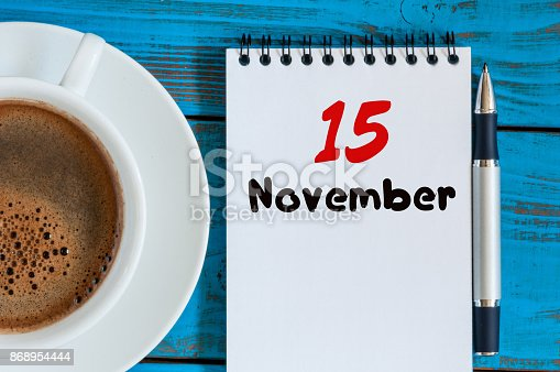 868951648 istock photo November 15th. Day 15 of month, hot coffee cup with calendar on accauntant workplace background. Autumn time. Empty space for text 868954444