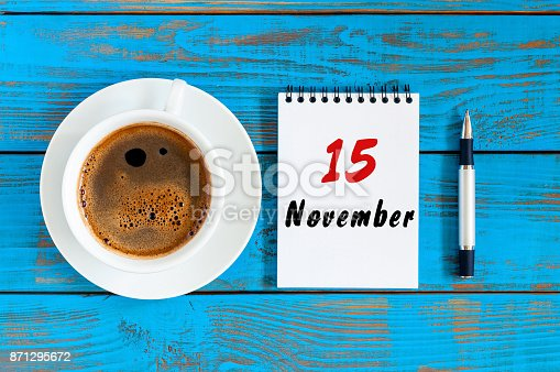 868951648 istock photo November 15th. Day 15 of month, hot coffee cup with calendar on accauntant workplace background. Autumn time. Empty space for text 871295672