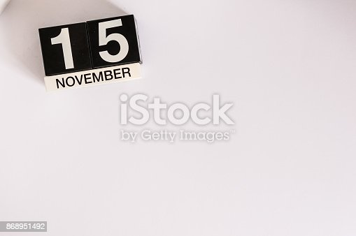 868951648 istock photo November 15th. Day 15 of month, wooden color calendar on white background. Autumn concept. Empty space for text 868951492