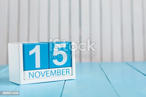 istock November 15th. Image of november 15 wooden color calendar on blue background. Autumn day. Empty space for text 868951648