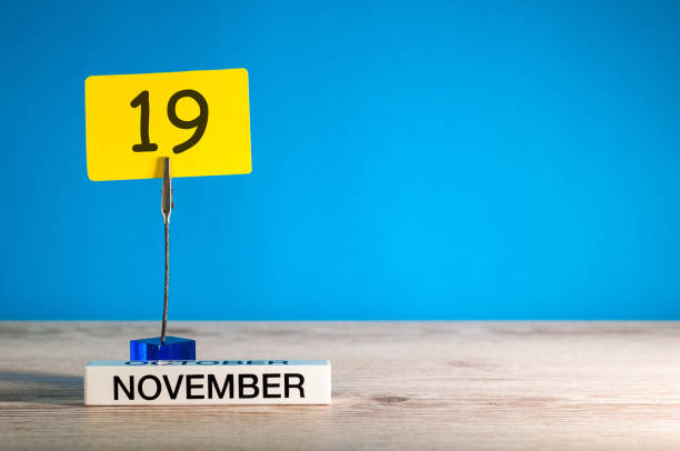 November 19th Day 19 Of Month Calendar On Workplace With Blue Background