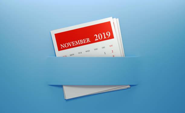 november 2019 kalender in blauem hintergrund eingefügt - planner inserts stock-fotos und bilder