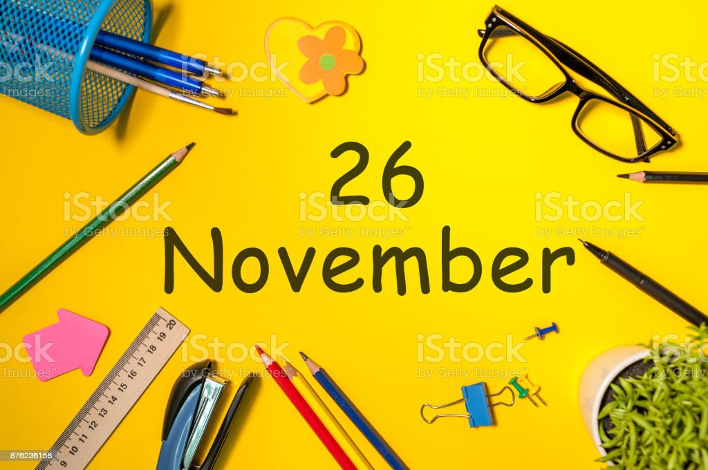 November 26th. Day 26 of last autumn month, calendar on yellow background with office supplies. Business theme stock photo