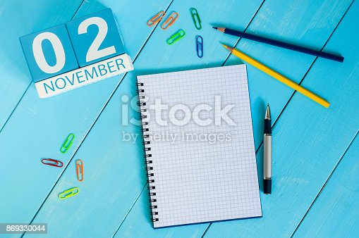 868951648 istock photo November 2nd. Image of november 2 wooden color calendar on blue background. Autumn day. Empty space for text 869330044