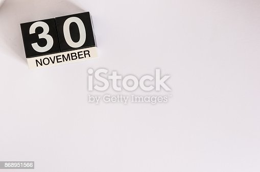 868951648 istock photo November 30th. Day 30 of month, wooden color calendar on white background. Autumn fall. Empty space for text 868951566