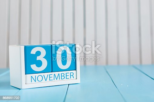 868951648 istock photo November 30th. Image of november 30 wooden color calendar on blue background. Autumn day. Empty space for text 868951702