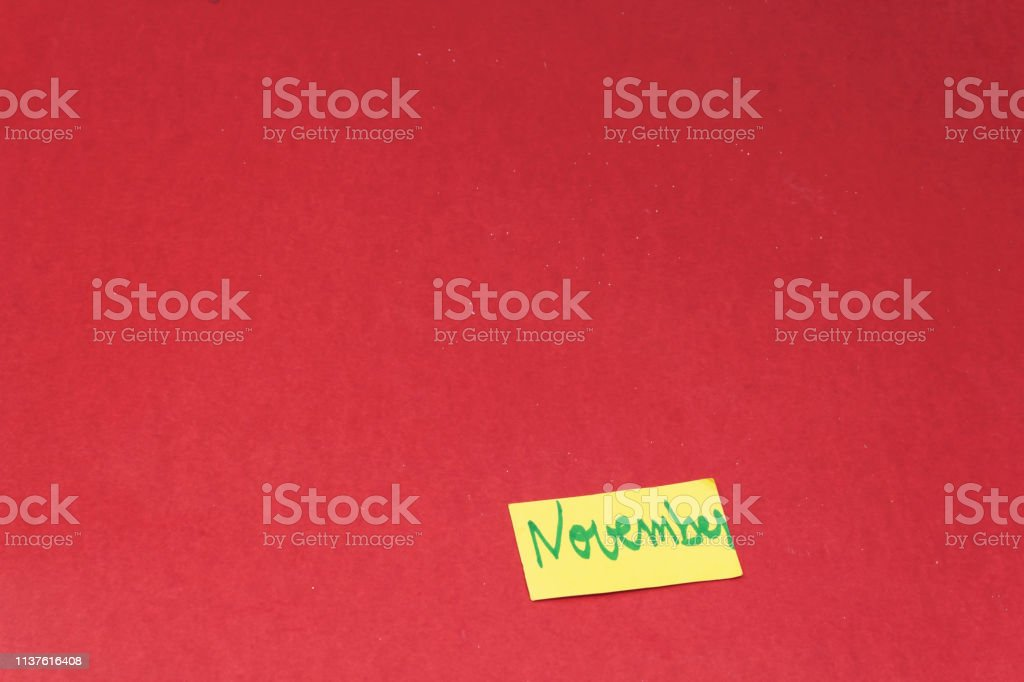 November Card isolated on red background stock photo