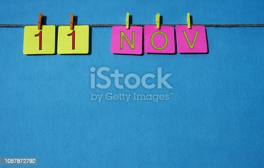 istock November, copy space with rope colored papers calendar 1057872792