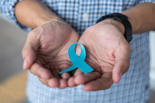 1168142443 istock photo November Prostate Cancer Awareness month, Man in blue shirt with hand holding Blue Ribbon for supporting people living and illness. Healthcare, International men, Father and World cancer day concept 1168853382