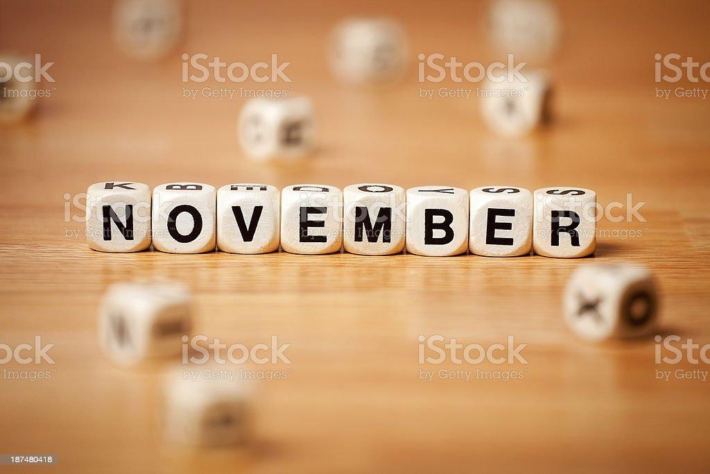 November spelled in letter cubes.