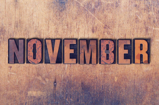November Theme Letterpress Word on Wood Background stock photo