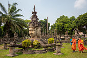 istock Novice Buddhist Monks at Xieng Khuan Buddha Park in Vientiane, Laos 1308610956