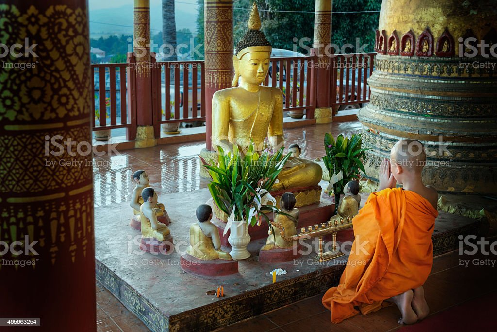 Novice Monk Praying At The End Of The Day stock photo