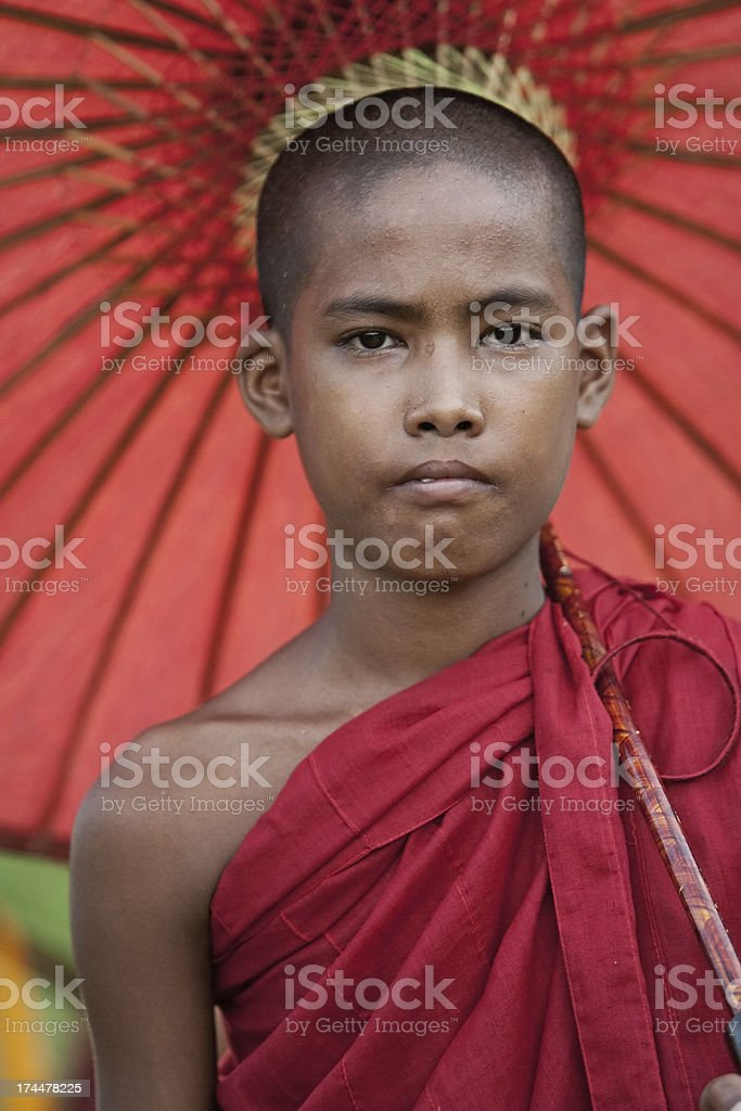 Novice monk with umbrella royalty-free stock photo