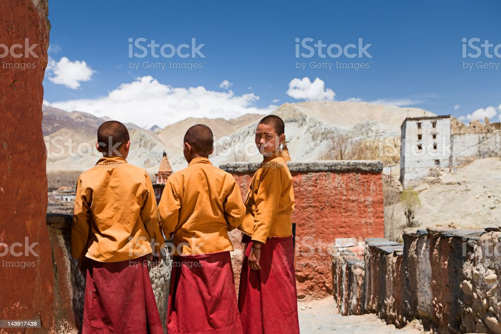 Novice monks in Tibetan monastery. Mustang. stock photo