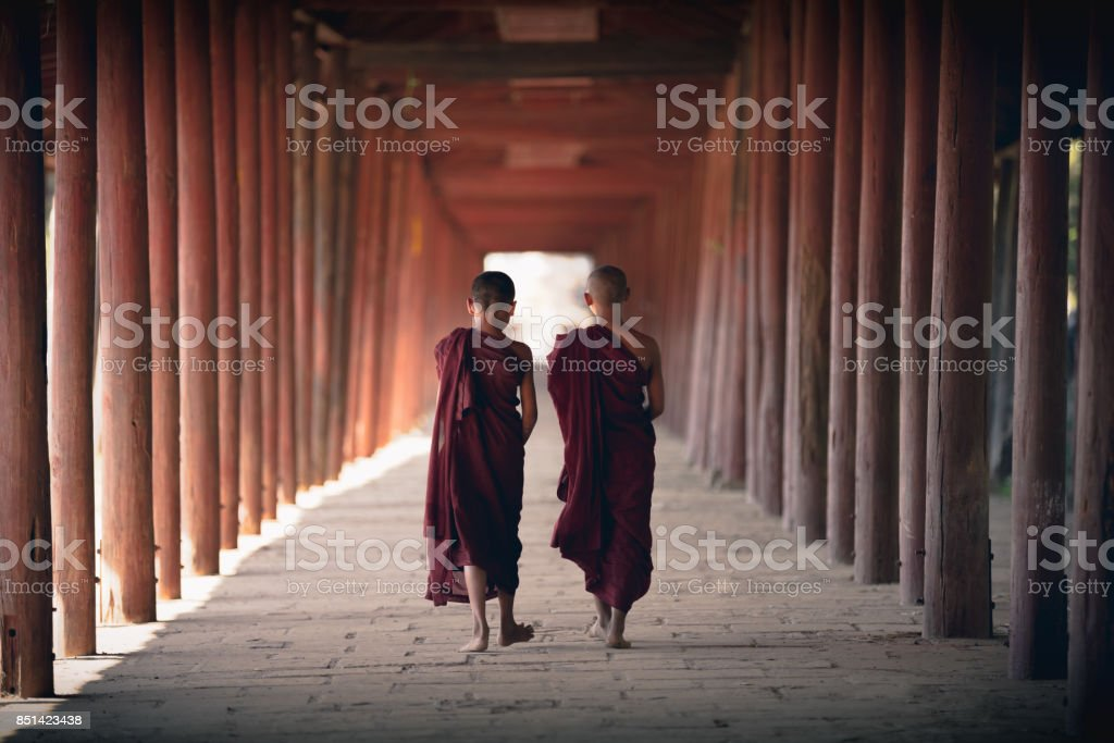 Novices walking at old temple stock photo