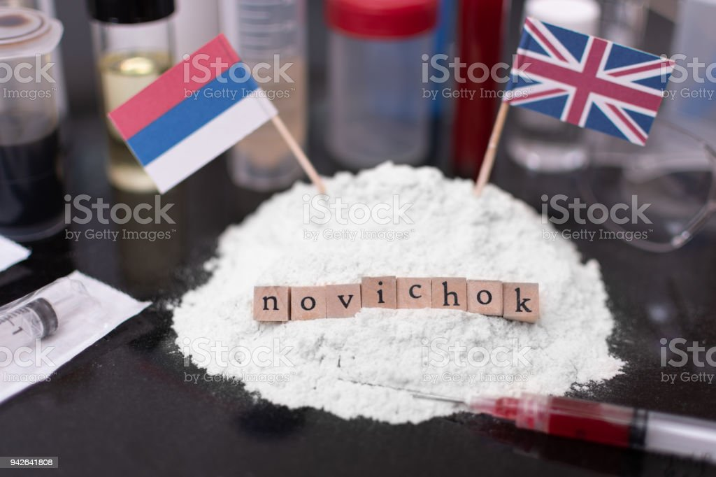 Novichok Nerve Agent Concept - Russian and UK Flags with blood in a syringe royalty-free stock photo