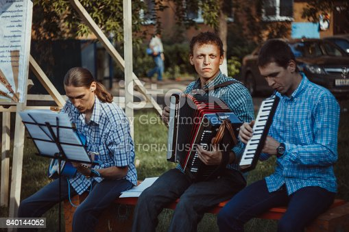 Novokuzneck, Russia - 7.04.2013: the musicians play guitars and sing songs in the yard of the city of Novokuznetsk in Russia.