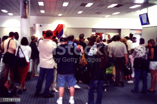 People lining up to board a flight at the Atlanta airport