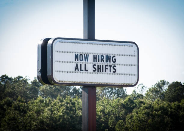 """""""Now Hiring All Shifts""""  Sign A business openly advertises work opportunities. help wanted sign stock pictures, royalty-free photos & images"""