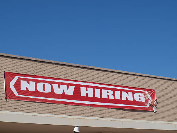 Now Hiring Sign stock photo