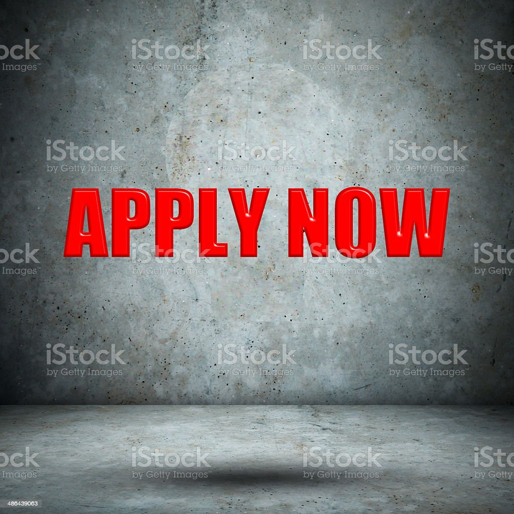 APPLY now on concrete wall stock photo