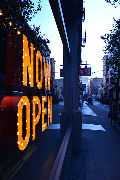 Now open sign on streets Soho Manhattan New York stock photo
