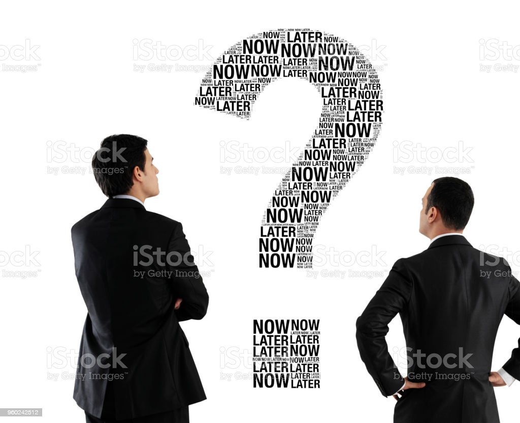 Now or later? stock photo
